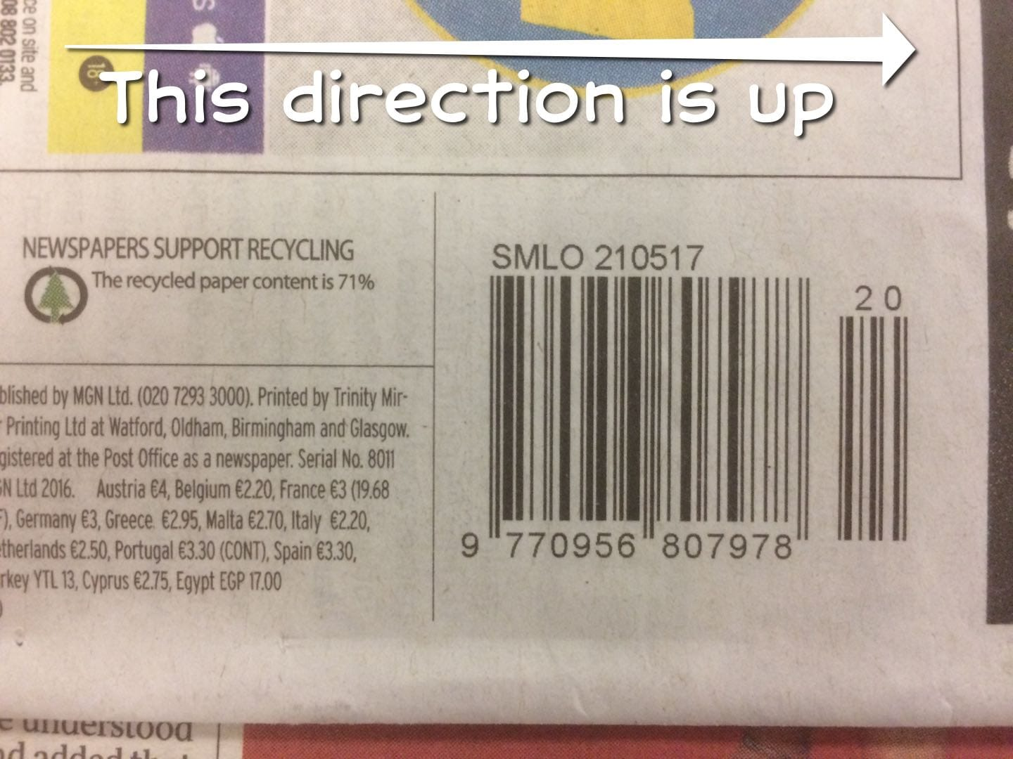 A photograph of a barcode on the back of the Sunday Mirror, rotated so that it is placed sideways on the page.